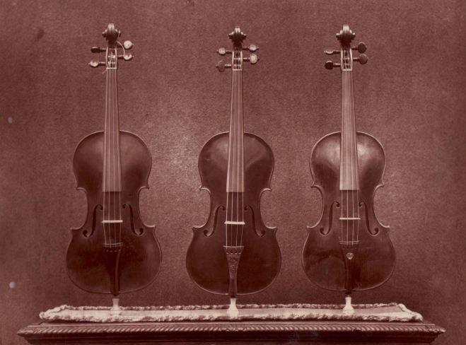 The Messiah flanked by La Pucelle and del Gesu's Violon Diable photographed in 1872 whilst still the property of Vuillaume.