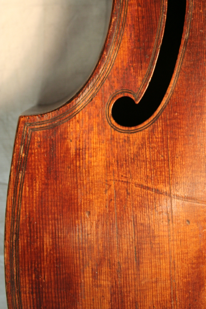 Jaye's varnish is much finer on the fronts of his instruments, wearing to a slightly blotched look on this 1624 example.